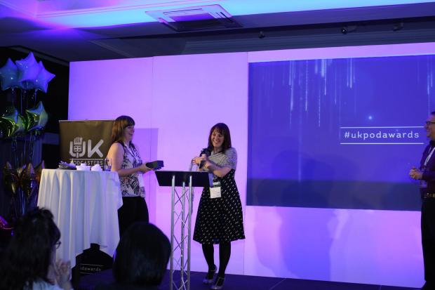 Jo Milmine accepting UK Podcasters Award for Most Engaged Audience